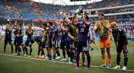 Japan dankzij bizarre ontknoping naar achtste finales WK